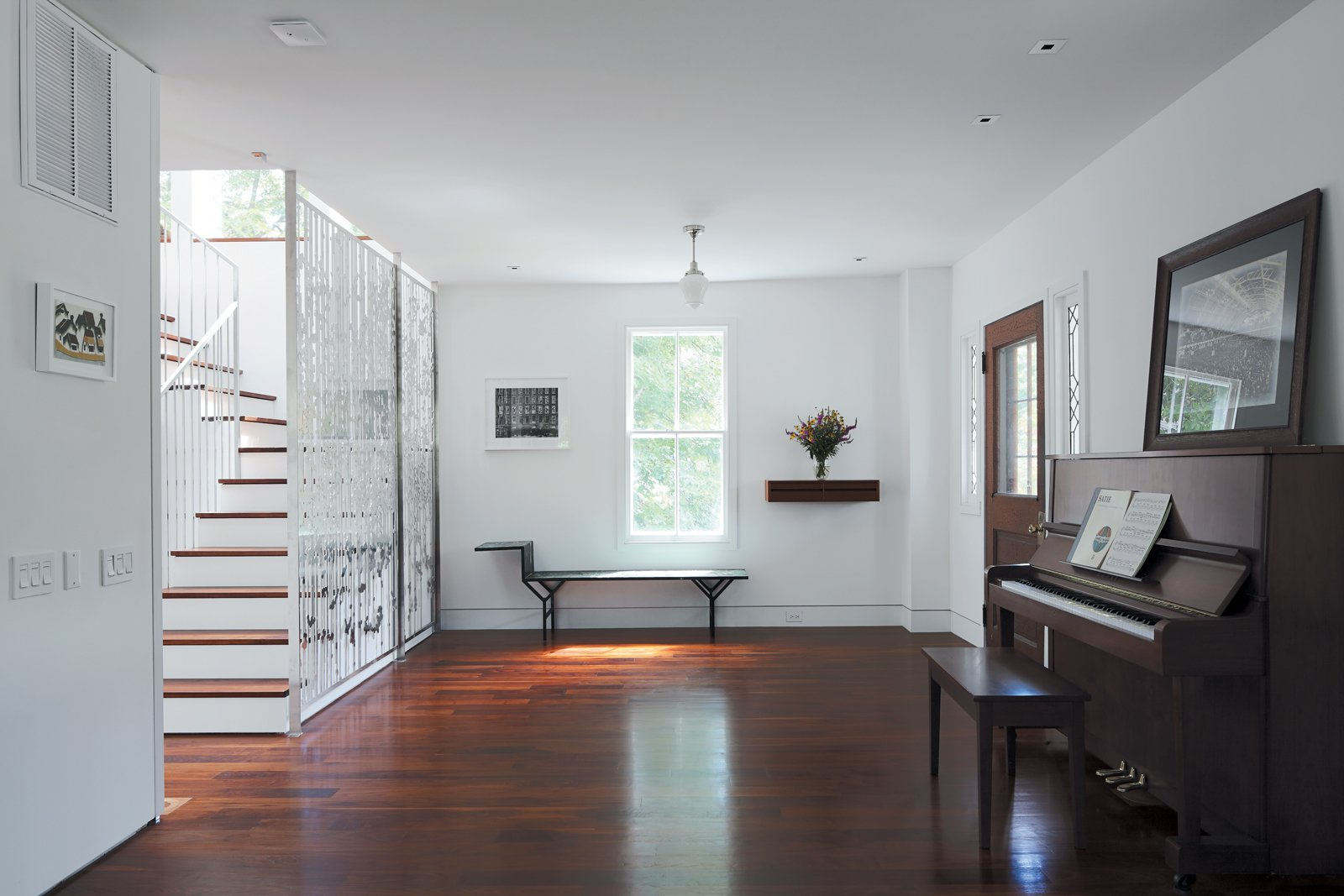 Combining old and new, Renaldi and Boyd placed the   latter's family piano and a painted metal Jean Prouvé bench in   the entryway, each a fine counterpoint to the filigree of Magnes's screen.  190+ Best Modern Staircase Ideas from An 1850 schoolhouse in Milford, Pennsylvania