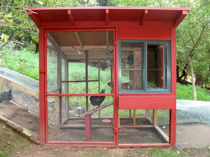 The main house uses new and salvaged lumberyard materials, including an inexpensive sliding window from Lowe's. There's a planting box under the window. The sleeping area is completely insulated with rigid foam sheathing. For cold nights there is a heat lamp.  Photo 2 of 4 in The Dos and Don'ts of Building Your Own Chicken Coop
