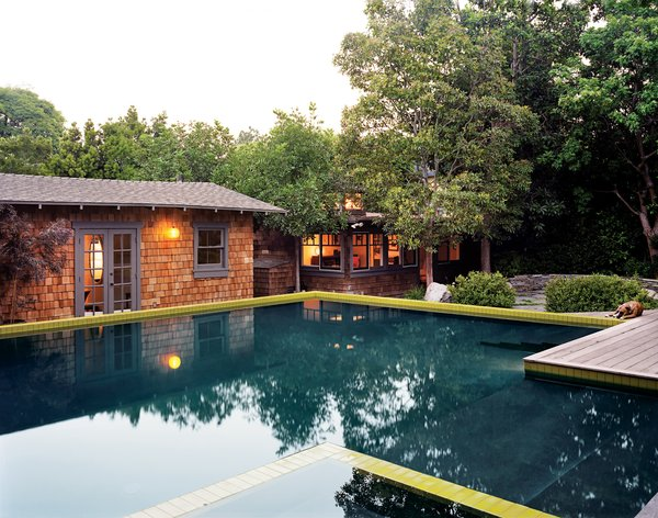 Before the addition of the approximately 750-square-foot pool (and its 65-square-foot hot tub), the lot was a scramble of structures: the house in one corner and the guesthouse and the office each occupying another.