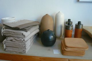 Here's a close up of Judy Jackson's pottery, bracketed by wood-and-metal candlesticks and Tunisian bath towels. If you like what you see, stay tuned for another Lost & Found slideshow, coming at you next week...