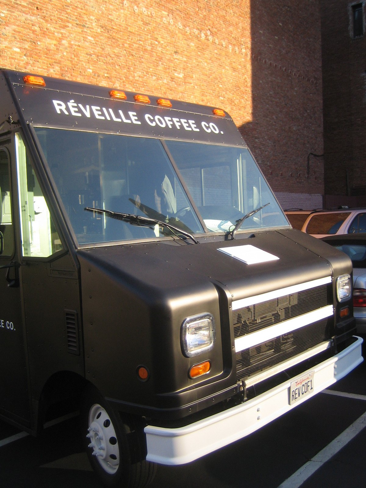 "Check out that vanity plate, ""REVCOF1.""  Photo 2 of 8 in Réveille Coffee Company Truck"