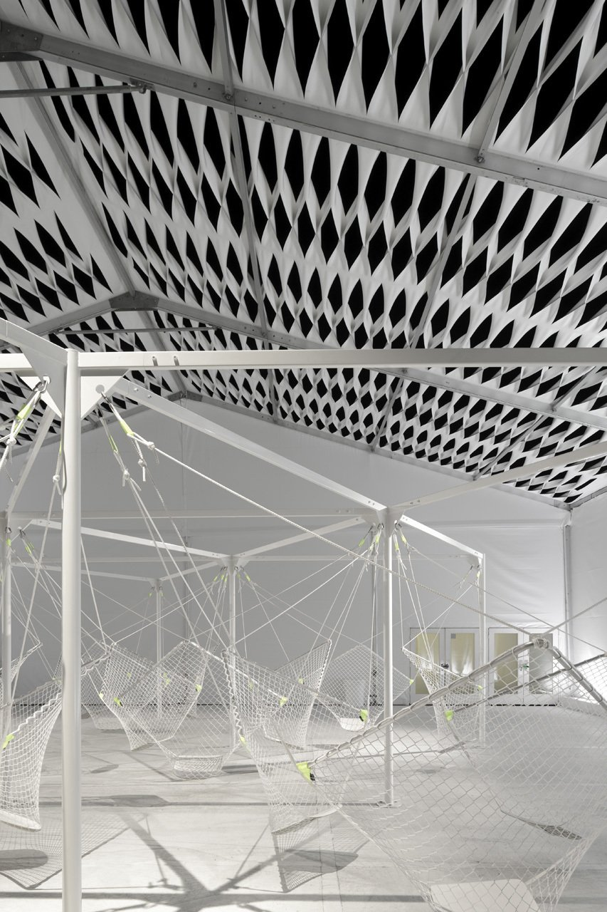 """The 24 seats fashioned from netting hang mid-air and are suspended by a metal frame. """"When we were shown [Grcic's] early renderings for Netscape, it was clear he understood the spirit of the space,"""" says Granger.  Design Miami's Deconstructed Tent  by Diana Budds"""