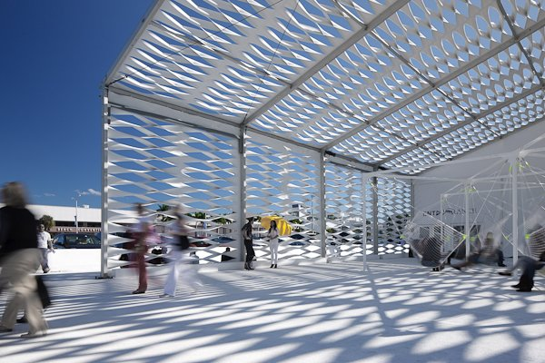 The tent's standard flat vinyl panels were manipulated by a simple pattern of hand-cut slits, folded to simultaneously open the panels and create a volumetric surface.  Design Miami's Deconstructed Tent  by Diana Budds