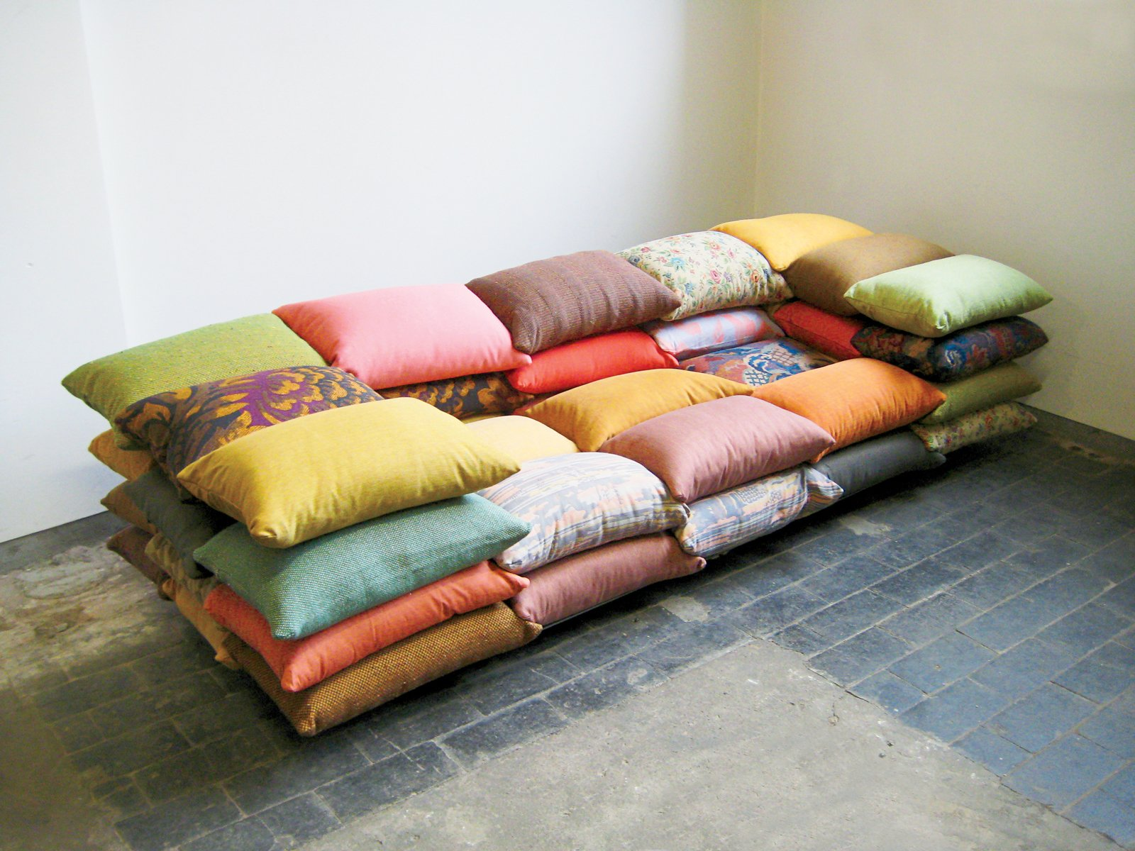 The cushioned sofa was originally a project in which Högner made a sofa from sandbags. This iteration takes the sofa's smallest component--the pillow--and builds up.  Photo 14 of 15 in Kind of New
