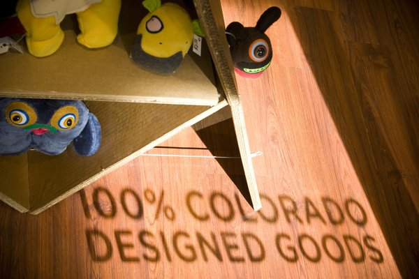 The shop features 100-percent locally designed goods from Colorado artists and designers. Corrigan tapped into another source of local talent for this shop's design, working with students at the Art Institute of Colorado in Denver to concept the store's layout.