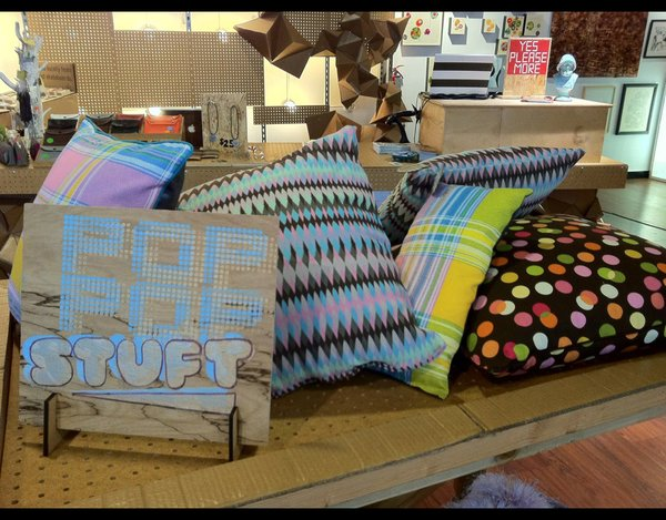 On sale here are pillows made by Pop Pop Stuft.