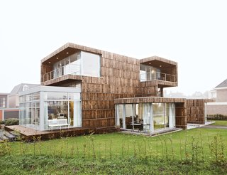From the outside, the house appears as a composition of cubic volumes that barely hints at its reused nature. Expanses of glass, skylights, terraces, and balconies all strengthen the relationship between inside and outside and make the interior uniformly light.