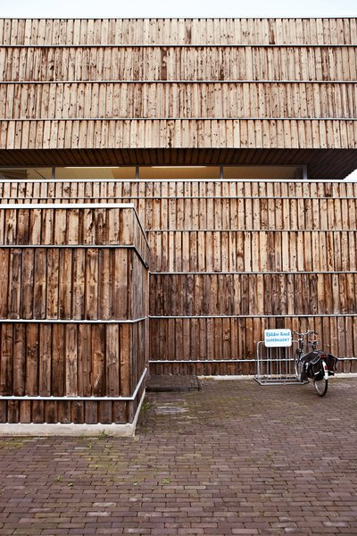 """The facade is clad with 600 recycled cable reels. According to Jongert, """"It took about seven minutes to dismantle each one, yielding quite a lot of wood each time."""" The wood was heat-treated at high temperatures, a natural weatherproofing technique."""