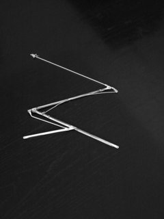 A detail of the original umbrella frame that was repurposed.