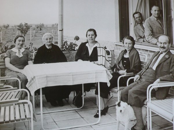 "Kozma, at right, with clients at the home he designed for them in the Hungarian village of Pókaszepetk–Taszilópusztai in 1935. Subjected to new ""Jewish laws,"" the family was forced to give up their home in 1947 and was relocated to Budapest. After the war the property was nationalized and later destroyed. Photo courtesy Szalon."