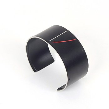 An old camera lens is upcycled into a fashionable cuff.  Photo 2 of 3 in Revisioning Camera Lenses
