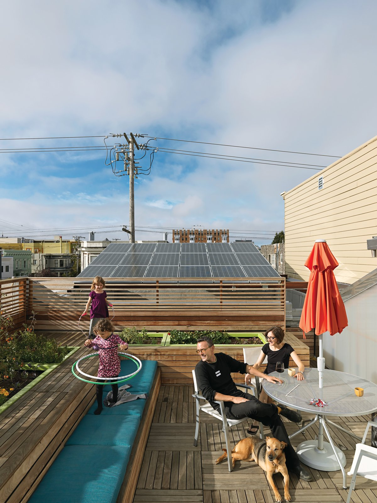 Outdoor, Rooftop, Wood, Vegetables, Horizontal, Gardens, Decking, and Wood The roof became the perfect location for their vegetable garden, as well as benches and a recreation space crowned by a hot tub powered by a four-kilowatt solar array.  Best Outdoor Vegetables Wood Photos from Just Redo It