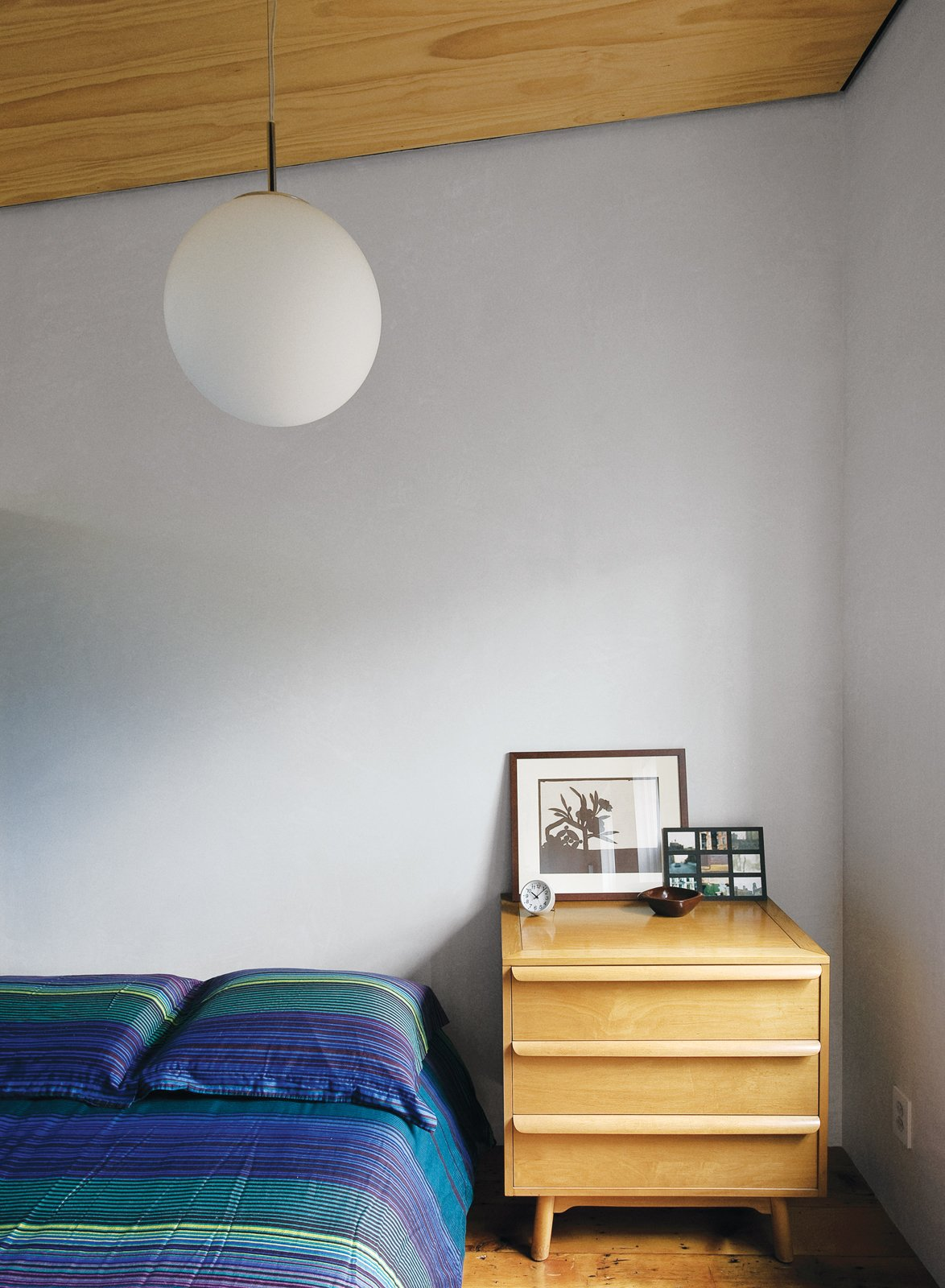 Bedroom, Pendant Lighting, Bed, and Night Stands Lange's predilection for vintage design punctuates the space. The office level includes a cozy guest room with a mid-century Heywood Wakefield-esque dresser serving as a bedside table.  Photo 11 of 28 in Family Home Renovation in Brooklyn