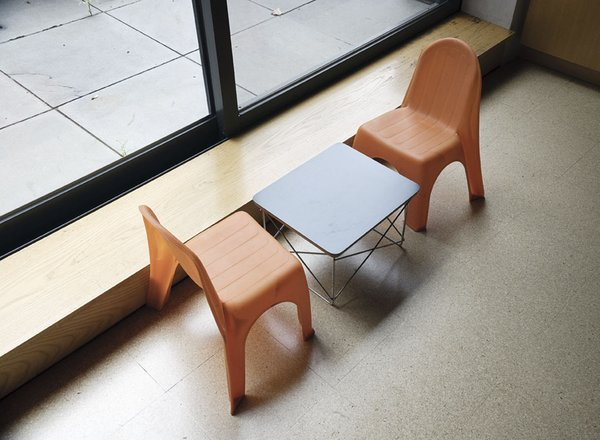 A small Eames Wire-base table provides the perfect dining space for son, Paul.