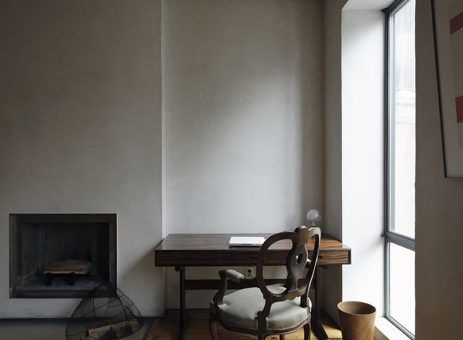 On the parlor level, the distinctive pigmented plaster walls eschews the finish of paint.  Photo 26 of 28 in Family Home Renovation in Brooklyn