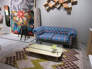 From there, Wilson steered me to the neighboring SCP booth, where her latest designs for the home were on display, including the Munro chesterfield sofa upholstered in her Bora Da fabric and a bunch of rugs, including the dynamic Scope rug leaning against the wall.