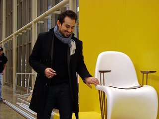 """In a unique fundraiser in partnership with Vitra called """"First Seating,"""" 20 of Canada's most celebrated designers and architects were tasked with rethinking and reimagining one of the design world's most iconic pieces—the Verner Panton S Chair. Here, designer Anwar Mukhayesh poses with his chair."""