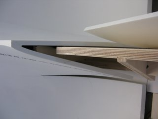 Here's a detail showing how the Corian skin fits over the plywood base.