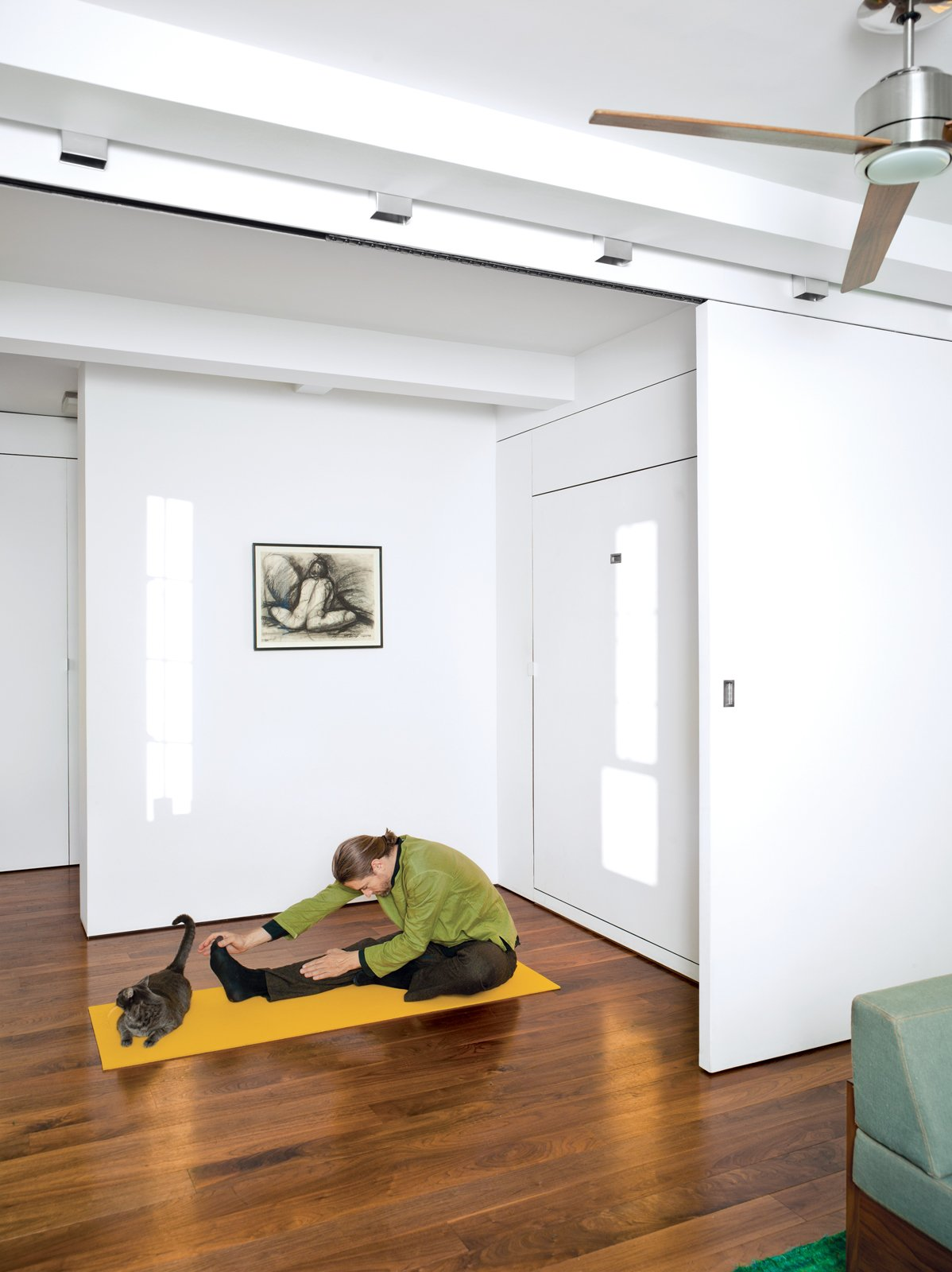 Once you fold up the Murphy bed in the bedroom, there's plenty of space for a stretch—even for Robert, who's six-foot-four.  Photo 3 of 14 in Stow Aways