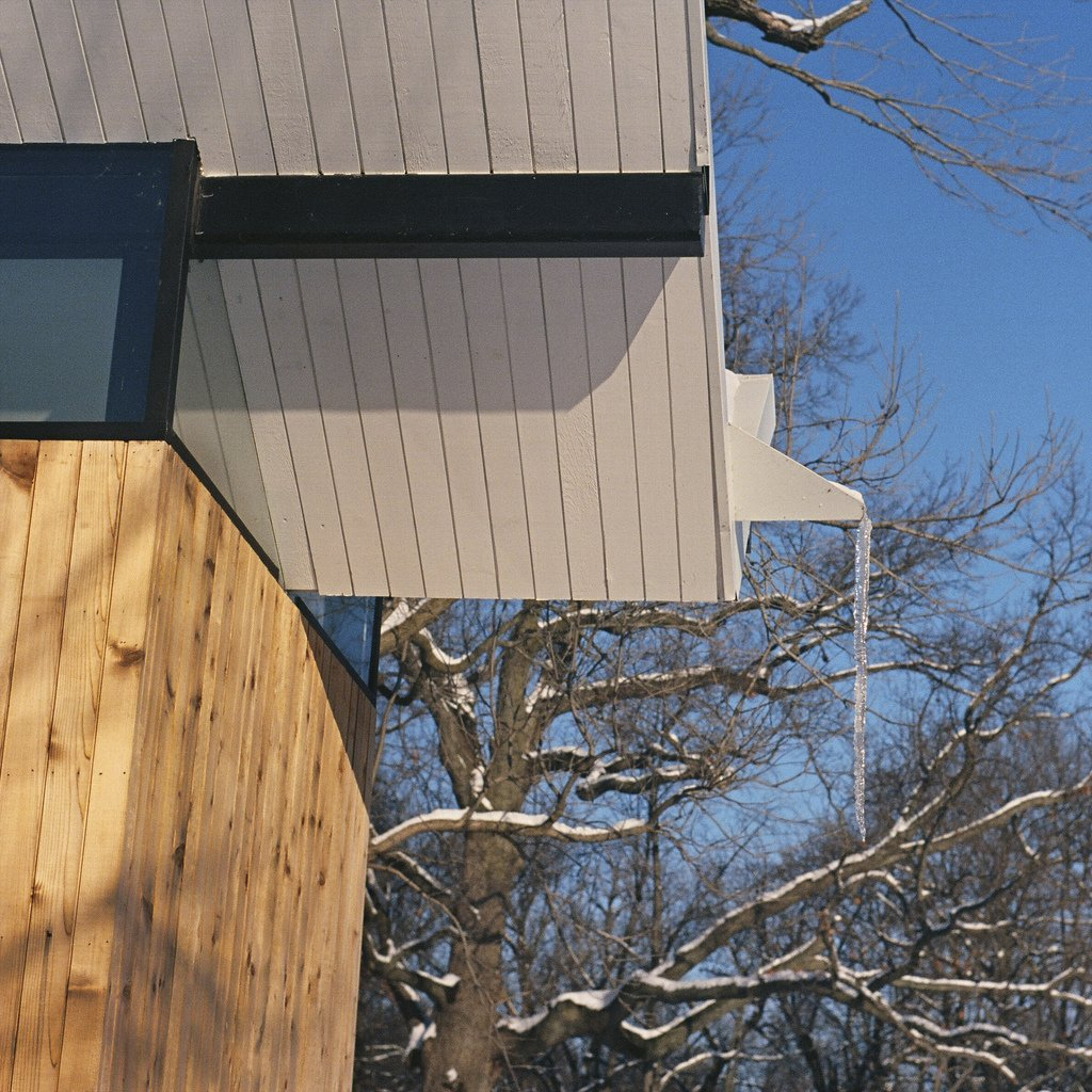 Exterior, Wood Siding Material, Cabin Building Type, and Butterfly RoofLine The V-shape roof, which dominates the structure's silhouette, channels rainwater to a central spout then into the pond—for most of the year. Photo by Phillip Kalantzis-Cope.  Butterfly Roof Meditation Hut by Miyoko Ohtake