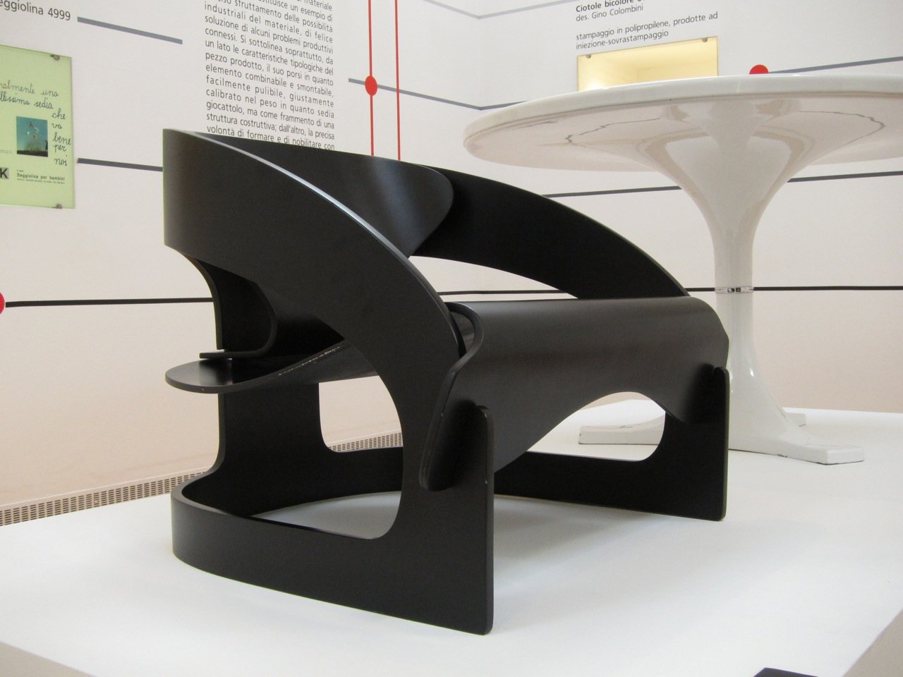 """A young Milanese architect named Joe Colombo realized the 4801 armchair in 1964. An anomaly in the catalog, the chair is made entirely from wood without the use of screws or glue.  Search """"joe colombo 4801 armchair"""" from Fantastic Plastics"""