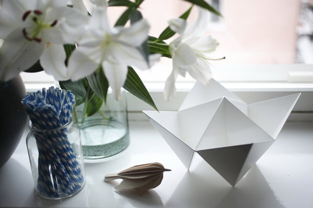 Susanna's skill as a stylist is evident in the apartment's many eye-catching arrangements of objects: here, a paper bird, a origami bowl, and a jar of striped paper straws.  Photo 5 of 16 in Fine Finnish