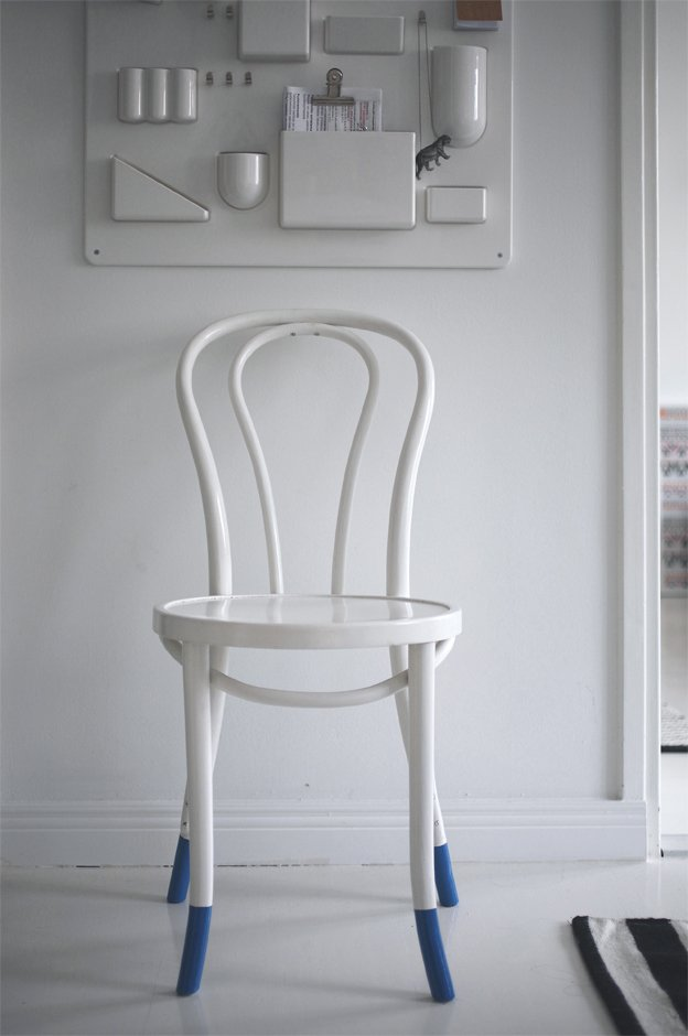 In the entryway, a plastic Uten.Silo organizer by Vitra shelters keys and other bits of potential clutter. A white-painted cafe chair suits the minimalist color scheme.  White room from Fine Finnish