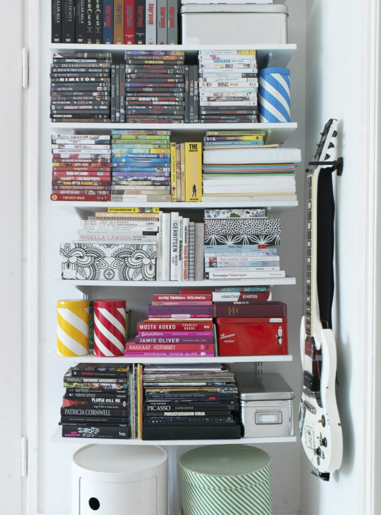 To keep her open storage neat, Susanna stacks and organizes her books and DVDs by size and by color.  Photo 11 of 16 in Fine Finnish