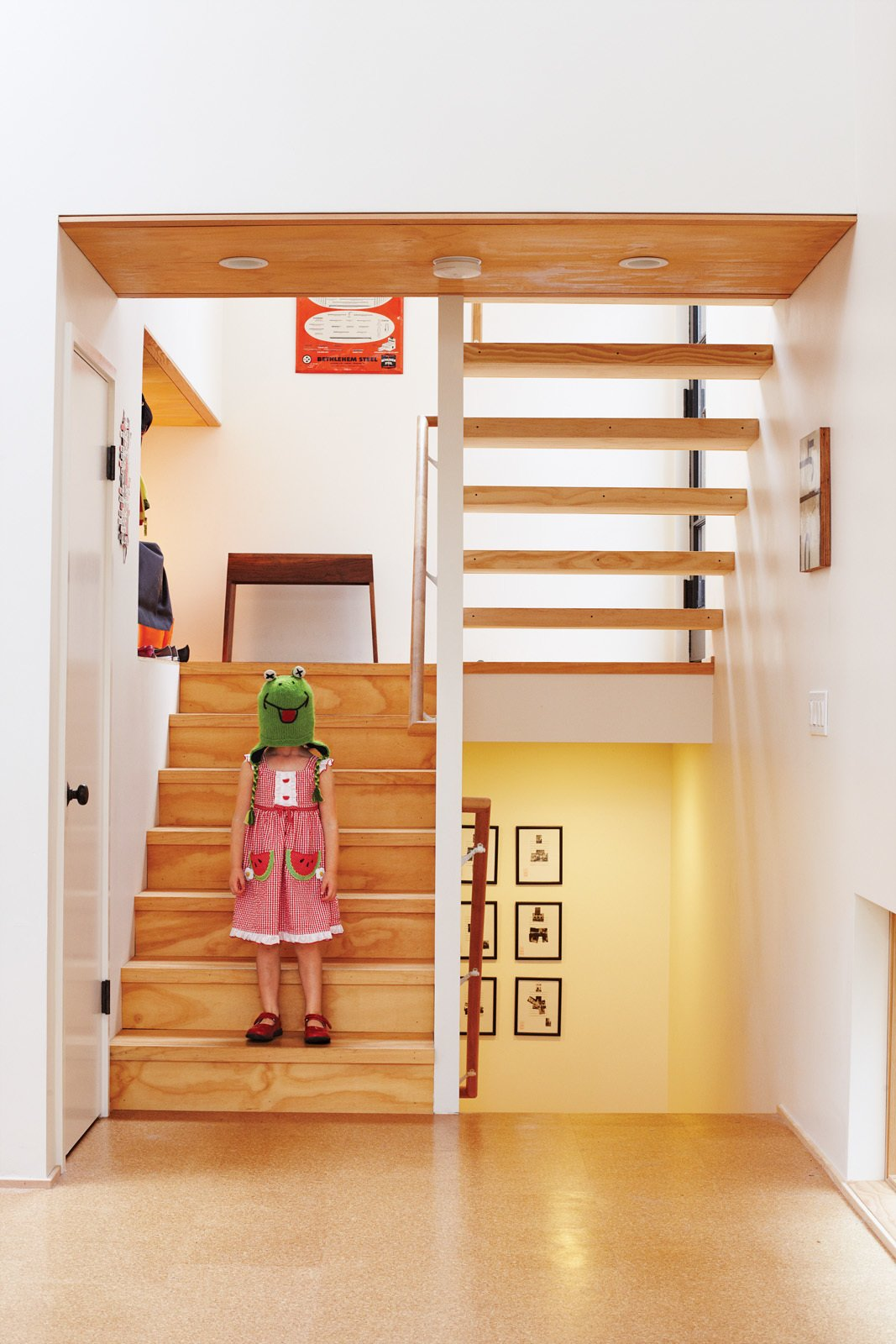 Just inside, Pippa, one half of the ever-entertaining twins, goofs around on the stairs leading from the entrance to the main floor and the bedrooms below.  Photo 2 of 21 in A New Slant