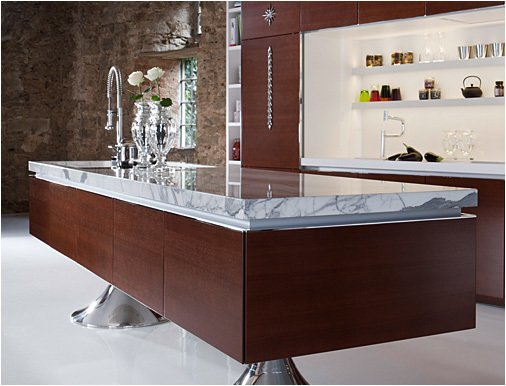 This dark, wood veneer version of the Library Kitchen exudes an entirely different, more contemporary vibe than the crisp white-and-olive version.  Photo 1 of 7 in Philippe Starck's Library Kitchen