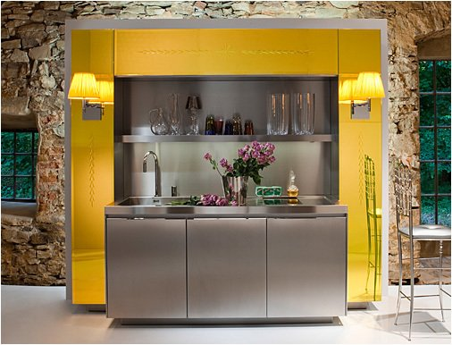 Bright and cheery, the Primary Kitchen combines the stainless steel of the Duality Kitchen and the color of the Library Kitchen.  Photo 5 of 7 in Philippe Starck's Library Kitchen