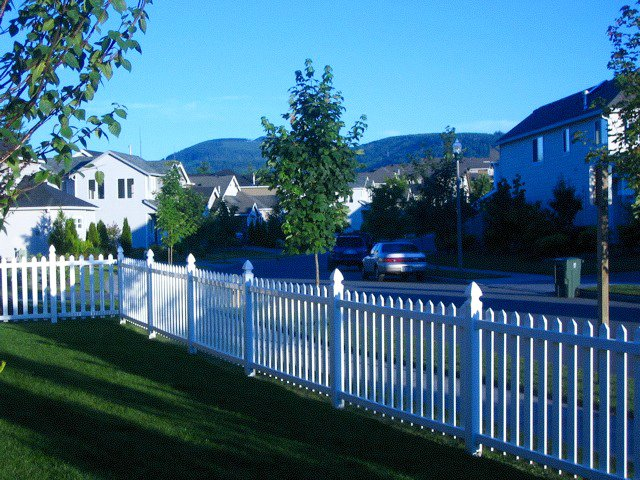 View from side yard. Corner lot, white picket fence, mountain view and streets lined with suburbia.  Photo 3 of 10 in Building the Maxon House: Week 1