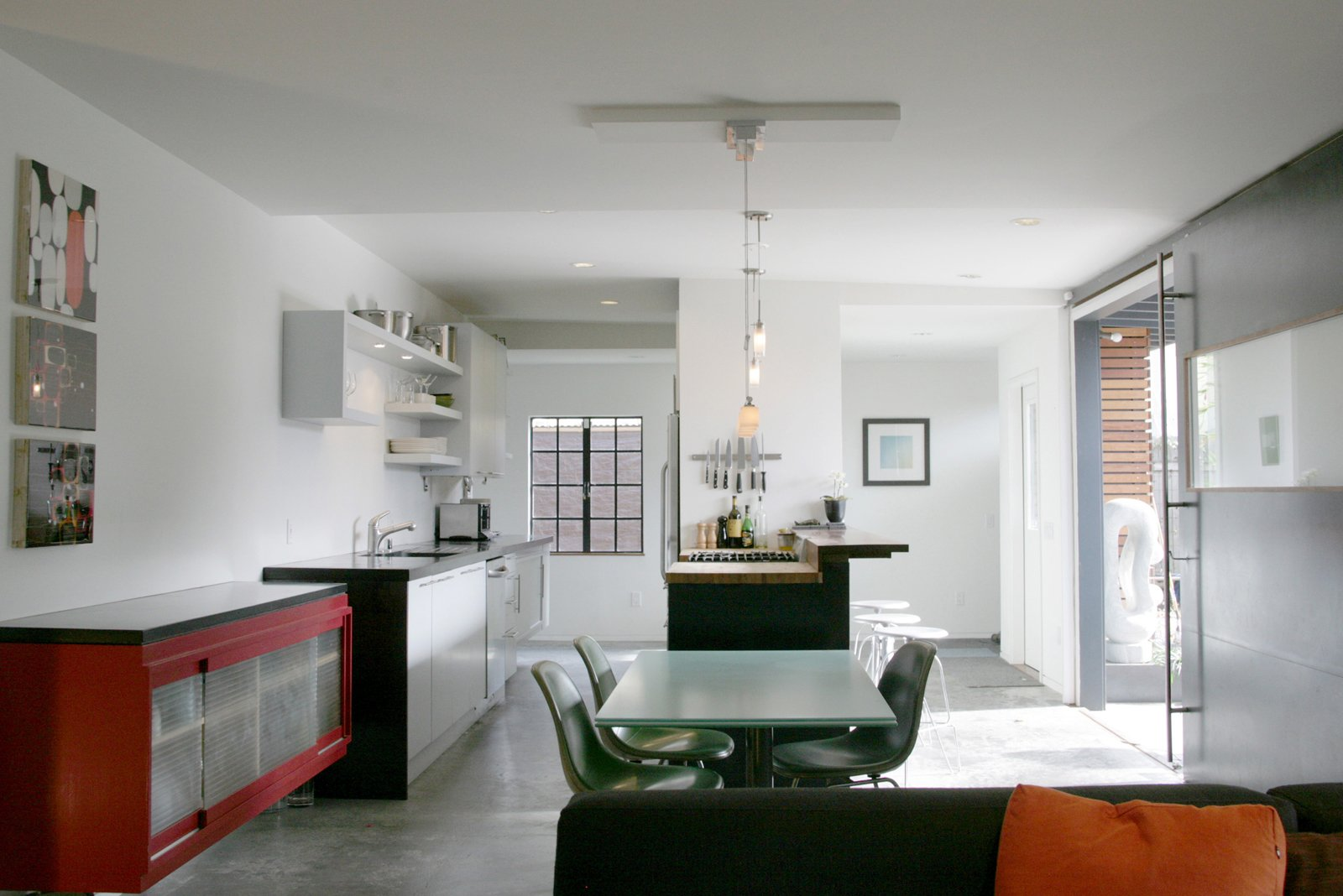 """In the kitchen and dining area, Shoup used ipe wood and installed an energy-efficient hydronic radiant heating system in the concrete floor. """"There's a minimalism that drives the basic design gestures,"""" notes Shoup. """"I tried to temper that with a complementary materials."""" Photo by building Lab inc.  Photo 3 of 11 in Creative Re-Use in Oakland"""