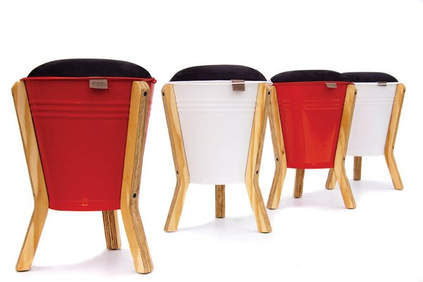 Bucket Stool   Designed by:   Pedersen + Lennard  In South Africa, objects tend to be overly designy without enough craft, or too crafty without enough design, says Luke Pedersen. His team has developed several pieces that strive for a balance between industrial and handmade components. In their version of the iconic South African bucket, the metal is powder-coated and fitted with digitally cut plywood legs. The seat works culturally in a similar way that   District 9 did: it's immediately accessible to an international audience, but with a special wink-wink-nudge-nudge for South Africans with nostalgia for bucolic days. A favorite with Expo visitors, this piece won the Western Cape Furniture Initiative's award for Emerging Designers.  More info:   pedersenlennard.co.za
