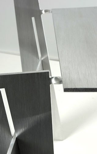 Each chair is folded from a sheet of 6-mm-thick aluminum. The points where the metal is twisted become delicate-looking hinges.  Photo 5 of 5 in Kadushin's Laser Cut Chairs