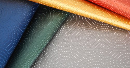 Kravet's Sta-Kleen performance fabric is a throwback to the 1950s formaldehyde resin fabrics, with its faux leather feel, raised circular designs and availability in five bright hues.  Photo 3 of 4 in Mid-Century Textile Design