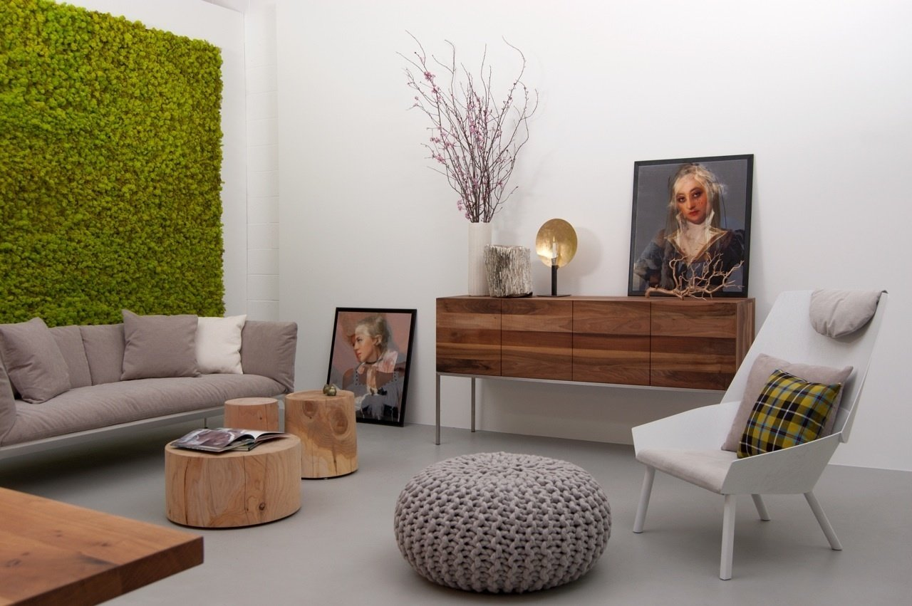 A view of the showroom, including the Yale Sofa by MDF Italia, on the left, the Legno Vivo Cedar small table collection by Riva 1920, the Farah sideboard in oiled European walnut with brushed stainless steel frame by e15, and the Eugene lounge chair designed by Stefan Diez for e15.  Supernatural San Francisco by Jaime Gillin