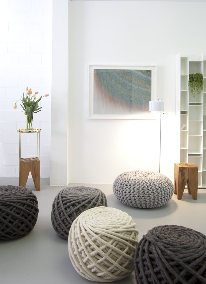 The shop's best-selling 'Urchin Poufs,' by Dutch-based Christien Meindertsma, are knit with gigantic needles. In the foreground are Meindertsma's Texelaar Ottoman Poufs. The wooden Backenzahn stools are by Phillip Mainzer for e15 and the ink-on-paper drawing, titled '5,604 Lines,' is by the San Francisco-based artist Alex Zecca.  Supernatural San Francisco by Jaime Gillin