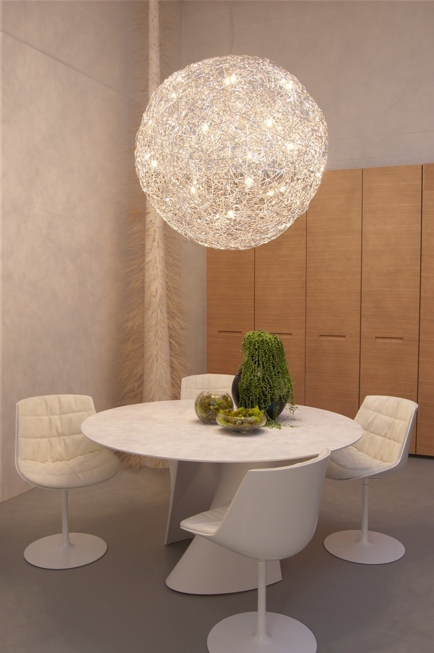 A Fil de Fer pendant light fixture by Catellani and Smith hangs over a S-Table in matte white resin by MDF Italia, surrounded by glossy Flow chairs. Along the wall is the Centopercento closet system by Tisettanta.  Don't miss a word of Dwell! Download our  FREE app from iTunes, friend us on Facebook, or follow us on Twitter!  Supernatural San Francisco by Jaime Gillin