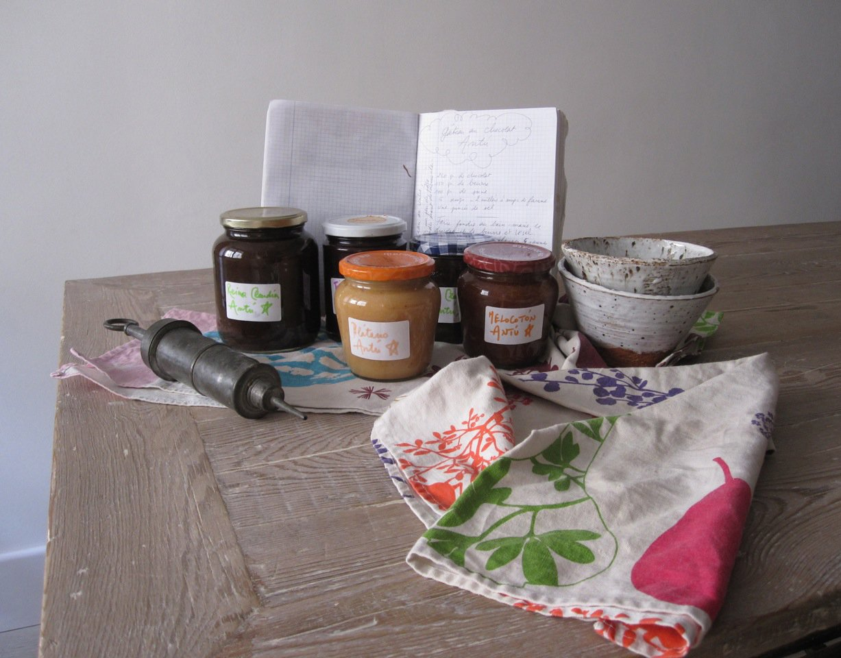 A selection of Carlos Mayor and Antoine Leonetti's homemade jams, their recipe journal, and bowls by Caroline Chevalier.  Photo 1 of 2 in Recipe: Creamy Banana Jam