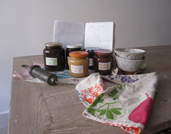 A selection of Carlos Mayor and Antoine Leonetti's homemade jams, their recipe journal, and bowls by Caroline Chevalier.