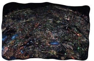 "Nishino also uses color photographs using the same process to produce ""i-Land"" and ""Night.""  Diorama Map Night, 2009/2010, Light jet print on Kodak Endura paper, 150 x 231 cm, © Sohei Nishino, Courtesy of Michael Hoppen Contemporary/ Emon Photo Gallery."