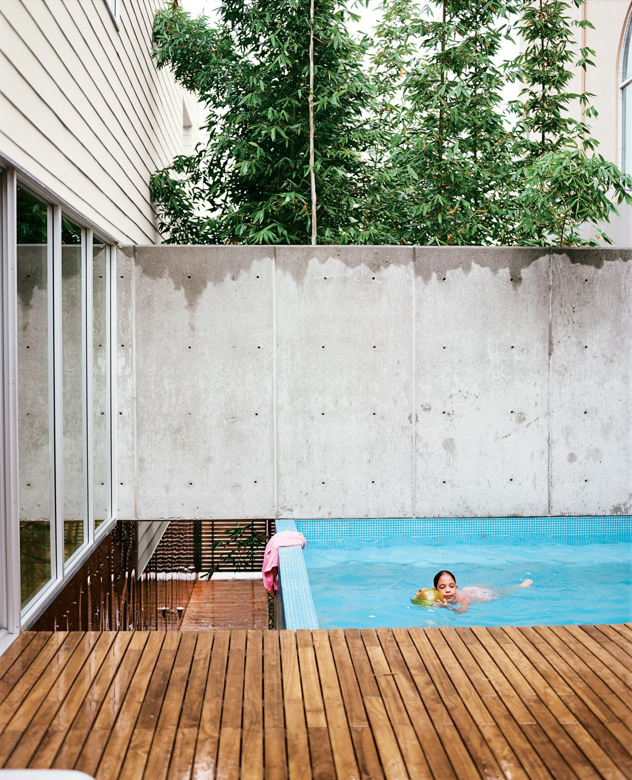 Outdoor and Small Pools, Tubs, Shower The small pool at the top of the landing provides the family with a place to cool off.  30+ Best Modern Fences by William Lamb from Modern in Tijuana