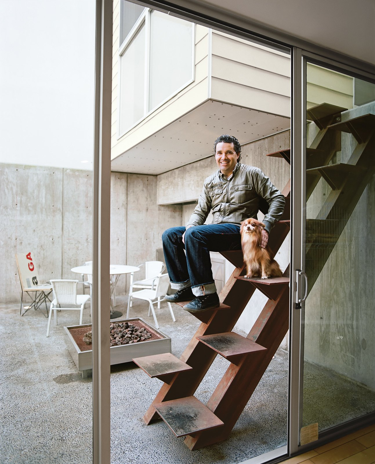 """Outdoor and Back Yard The architect Jorge Gracia sits on his handiwork, an unusual custom-made Cor-Ten stair leading from the courtyard to the guesthouse.  Search """"cor ten steel"""" from Modern in Tijuana"""