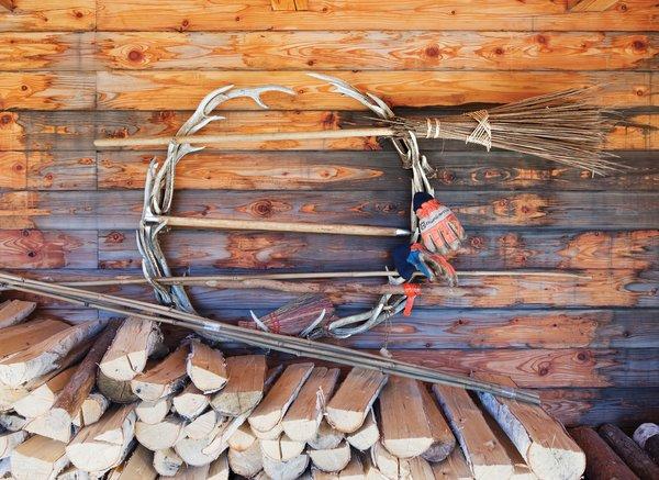 The couple stockpiles wood under the deck.