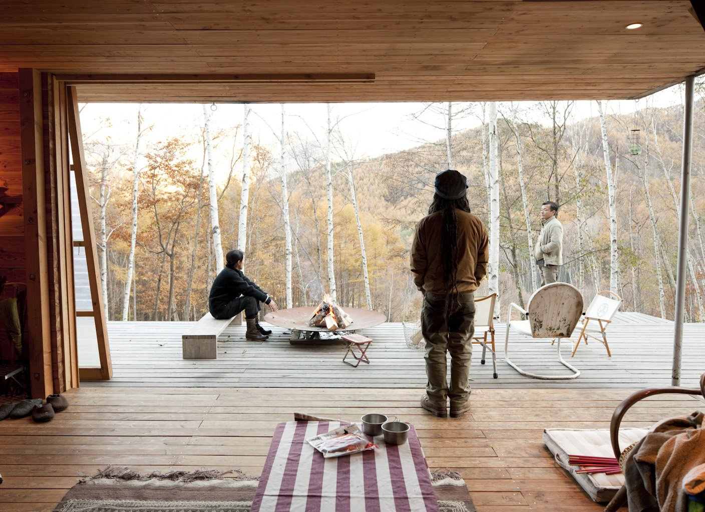 Outdoor, Wood Patio, Porch, Deck, and Large Patio, Porch, Deck Even in cold weather, they open the sliding doors to let the fresh air in.  Photos from A Platform for Living