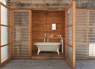 The ultimate luxury: a hot bath in the clawfoot tub, with the fiberglass door open wide to the woods.