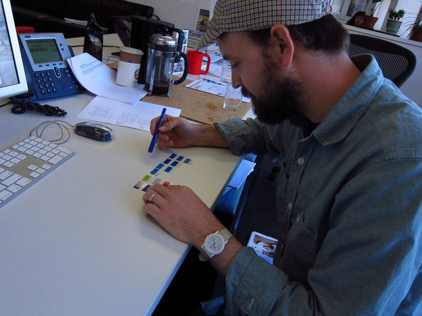 Kyle intently studies the swatches.  Photo 3 of 8 in Friday Finds 4.01.11