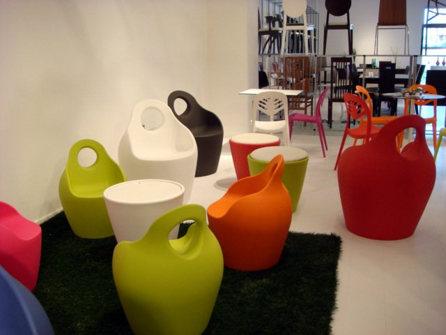 DOMITALIA presented an eye-catching group of day-glo outdoor seating, which included the Baba armchairs and coffee table designed by Radice & Orlandini in the foreground and the Foryou2 by Dual Design in the background.  High Point Market 2011 by Diana Budds