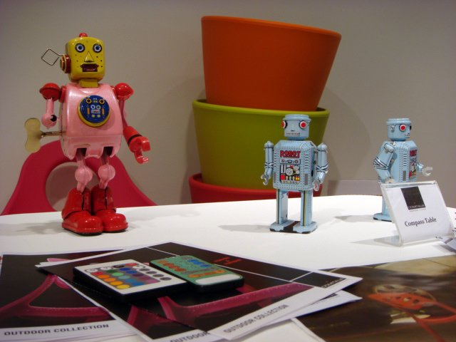 A trio of toy robots on display at DOMITALIA.  High Point Market 2011 by Diana Budds